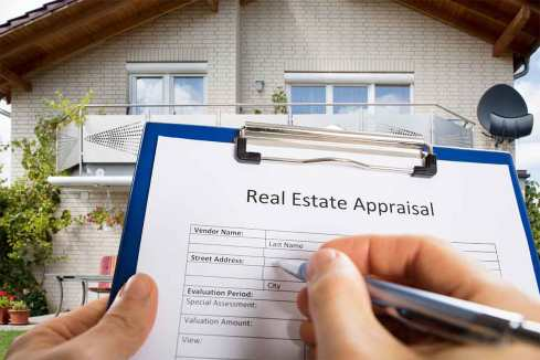 house-appraiser-holding-appraisal-sheet